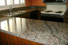 A short time later, this kitchen has been transformed from a tired laminate countertop to one that looks like granite for a fraction of the price.