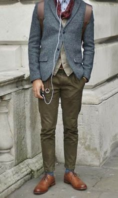 Shop this look for $386:  — Navy Wool Blazer  — Tan Waistcoat  — Blue Socks  — Brown Leather Derby Shoes  — White and Blue Vertical Striped Dress Shirt  — Burgundy Scarf  — Dark Brown Leather Backpack  — Olive Chinos   http://lookastic.com/men/looks/blazer-and-waistcoat-and-socks-and-derby-shoes-and-dress-shirt-and-scarf-and-backpack-and-chinos/627