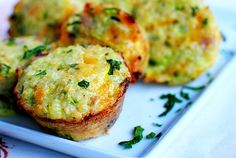 Quinoa egg cups  2 cups cooked quinoa (about 3/4 cup uncooked)  2 eggs  2 egg whites  1 cup zucchini, shredded  1 cup shredded sharp cheddar cheese  1/2 cup diced ham  1/4 cup parsley, chopped  2 Tablespoons parmesan cheese  2 green onions, sliced  salt & pepper  350 - 15 to 20