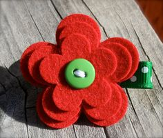 red felt flower, button, ribbon, sculpture, hair, bow, band, clip, accessory
