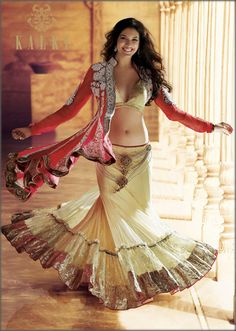Red and cream lengha choli with long jacket done in heavy embroidery by Kalki