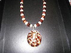 Sea Shell and Red cats eye