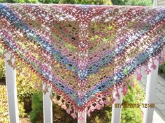 This is my newest crochet creation ~ the Flora Shawl on Ravelry. The original pattern is the Porcelain Berry Shawl by the talented designer, Lena Fedotova