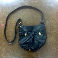 Gorgeous Black Purse with Gold Detailing This gorgeous black bag is perfect for any season! It can be worn cross body or on the shoulder! Check it out! The Many Moods of Poppie Jones Bags