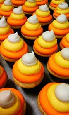 Check out these candy corn cupcakes, perfect for Halloween. These cupcakes are double Madagascar vanilla cake, topped with a ring of orange, yellow and white double Madagascar vanilla buttercream.