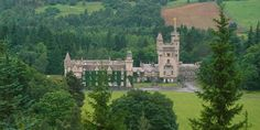Looking across to Balmoral Castle from the south side. Balmoral Castle is a large estate house in Royal Deeside, Aberdeenshire, Scotland. It is located near the village of Crathie, 6.2 miles west of Ballater and 6.8 miles east of Braemar.