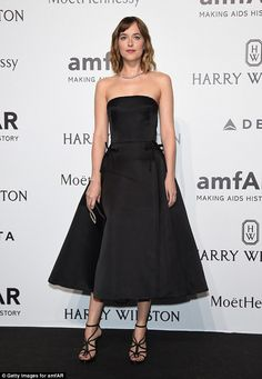 Classic elegance: Dakota Johnson kept things simple in a classic a-line cut Dior dress - amfAR Milano 2015 - Best of Harry Winston - September 26, 2015