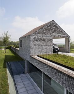 Built in the Belgian countryside, this house by Stéphane Beel Architects features an attractive and extremely intelligent arrangement of different spaces within a traditional farmhouse context. Built into the...