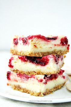 Lemon Raspberry Cheesecake Bars - – creamy cheesecake bars with raspberry pie filling swirl. Sweet, creamy and delicious! crunchycreamysweet.com