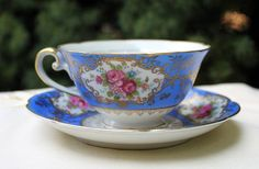 Antique cup and saucer. Hand painted in by AnythingDiscovered, $46.00