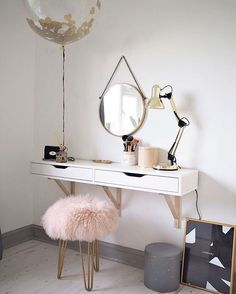 A simple but beautiful dressing table, with an IKEA top and pink and gold colour scheme