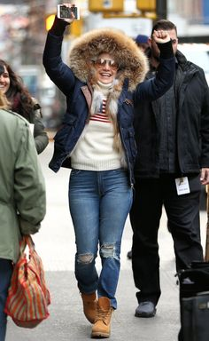 Jennifer Lopez in a sweater, parka, jeans and boots- click through for more celebrity outfit ideas