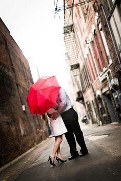 engagement couple prop red umbrella