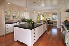 Kitchen with white cabinets, soapstone counters, and beadboard ceiling – FGY Architects