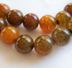 One 15+ inch strand (39 10mm beads) orange, brown, amber fire agate druks, high quality semiprecious gemstone beads 00401
