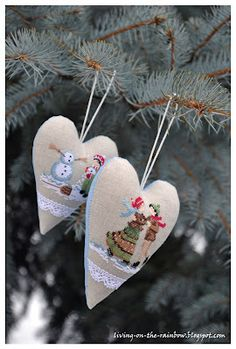 Heart shaped needlework hanging ornament...great idea to finish off a piece of work, instead of using wooden hoop.