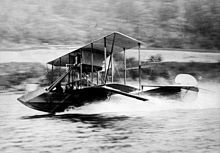 Curtiss Model F . Gustave Maurice Heckscher in his Curtiss seaplane at 60 miles per hour circa 1912