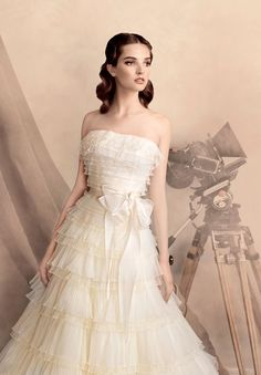 Your guests won't be able to take their eyes off of you in this soft tulle gown! http://papilioboutique.com