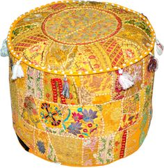 "Vibrant and colorful handmade ""Khambadiya"" ottoman pouf cover from Rajasthan, India! Incorporates sophisticated patchwork in many shades of vibrant color made from many exquisite and carefully chosen and arranged cuttings from saris, lehngas and wedding dresses."