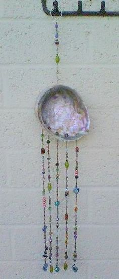 hanging art: shell, glass beads, Swarovski crystals Include in vignette above my desk