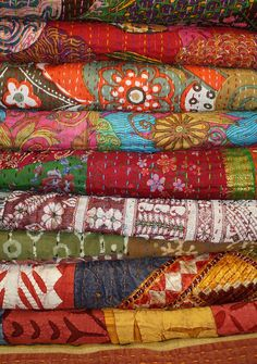 bohosantafetrail:  Pile of quilts by Sarah Bell Smith