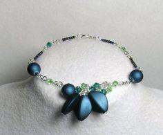 Crystal Design, Matching Necklaces, Crystal Bracelets, Necklace Designs, Peridot, Bud, Swarovski Crystals, Emerald, Teal