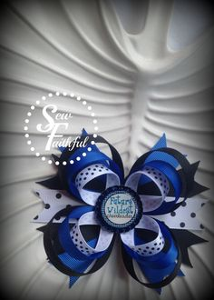 UK Wildcats Bottle cap Hair Bow. $5.50, via Etsy.