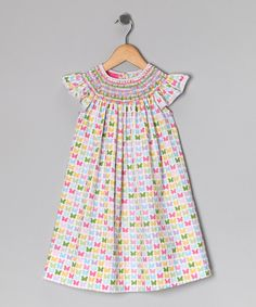 This darling dress sports some truly stupendous smocking. The hand-embroidered design adds a charming touch to the airy angel-sleeve silhouette. Soft, high-quality cotton keeps little ones comfy and cool during family picnics and outdoor playdates. 100% cottonMachine wash; tumble dryImported