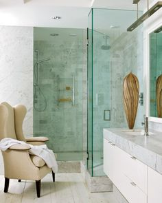 Darryl Carter . DC Condo . A 1940s wing chair graces the master bath.
