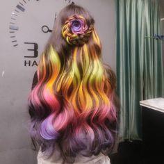 Brown hair with rainbow peekaboo highlights