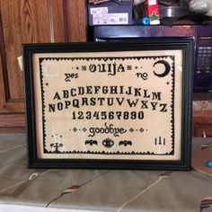 Ouija Board Cross Stitch - stitched by Susan Moser - 5 star Etsy Review. Pattern by The Witchy Stitcher