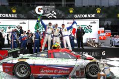 Here we see The Action Express Racing team as they celebrate their overall victory at the 52nd running of the #Rolex 24 at Daytona. Following a late-race dual with Wayne Taylor Racing, Action Express Racing broke through to claim victory in the 52nd #Rolex24 at Daytona, the opening round of the new TUDOR United SportsCar Championship.