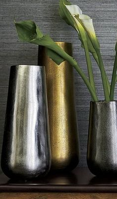 Made of sand-cast aluminum, the vase exhibits unique, rustic texture and glows with a warm antique brass finish. Group with other Element vases for a sculptural display or fill with dry botanicals or faux flowers. Our Element Metal Antiqued Brass Vase is a Crate and Barrel exclusive.
