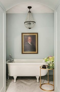 So cute, love the wall color.  A small space made larger with the size of the chandelier portrait, and tub.(bh)