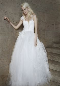 Look 20. Ivory tulle ball gown with draped bodice, cotton straps and lace technique accented by silk chiffon and tulle technique.