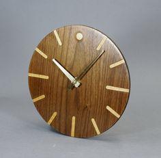 Walnut Veneer Wood Wall Clock 8 3/4 Inches In Diameter. $35.00, via Etsy.
