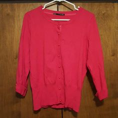 Pink button up sweater Maurices button up sweater. Stretchy fabric with button detail on the 3/4 length sleeve cuff. 70% rayon 30% polyester. Maurices Sweaters Cardigans