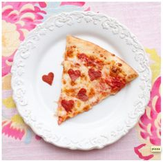 Valentine Heart Pizza - Make a special Valentine's Day dinner at home for your kids (or your sweetie). Add some heart-shaped pepperoni's to a store bought or homemade pizza. It's so easy. Just buy sliced pepperoni, cut heart shapes out with a small cookie cutter, and add to the pizza before cooking. This would be a sweet addition to any Valentine's Party as well.