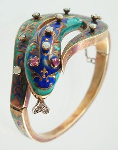 French enameled serpent bracelet Victorian C. 1860s-1870s Beautifully enameled gold serpent bracelet set with opals and ruby eyes. Diamond tongue. French hallmark.