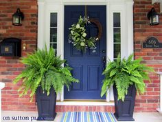 This isn't my front door, but it is exactly like mine.  The panels, the sidelites the brick, everything.  Even the planters on either side.  Coincidence?  I've been wanting to repaint it and this is the color I want.  (Naval by Sherwin Williams).  Now, I know exactly what my door will look like once I repaint it.