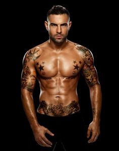 A sexy man with nicely tattooed body