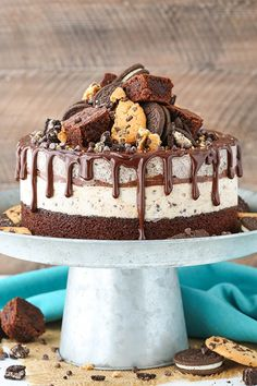 Oreo Brookie Ice Cream Cake - Layers of brownie, chocolate chip cookie and oreo ice cream, and chocolate ganache! So good and so fun! No churn too!