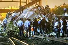 At least 5 dead as New York-bound Amtrak train derails. Emergency personnel work the scene of a train wreck in Philadelphia.