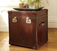 """Like trunks that have traveled the globe, the Expedition Cube has a timeworn appeal. Upholstered with aniline-dyed top-grain leather that reveals the natural markings and slight color variations that make each piece unique. Detailed with reinforced corners and contrast topstitching. Decorative lock, hinges, and corner brackets are crafted of zinc alloy. Detailed with 2 leather handles and 130 brass rivets. 20"""" wide x 18"""" deep x 22"""" high Please allow 2 to 4 weeks for shipping"""