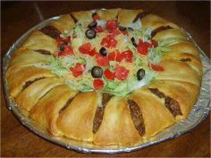 Crescent roll taco bake:  2 tubes cresçent rolls, 1 lb. Gr  beef or turkey, browned, add 1pk taco seasoning to meat, 1 1/2 c shredded cheddar, shredded lettuce, diced tomato, can sm blacksliced olives. Lay out tubes of rolls thick side in add more to middle. Top with meat mixture and cheese fold over rolls and tuck under meat and cheese. Cook per package  add whatever you like on taco's ..Enjoy