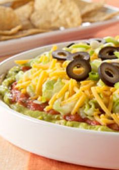 "PHILADELPHIA 7-Layer Mexican Dip – ""Seventh heaven"" is the only accurate way to describe a tortilla chip topped with the many layers of this creamy taco dip, which includes smooth cream cheese, guac and salsa."