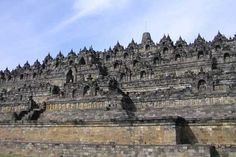Borobudur is an 8th century Buddhist structure, lost in the jungle until rediscovered in the 19th century. The structure is composed of two million cubic feet of stone set in six square platforms. Each platform is decorated with carved friezes. Five hundred statues of the Buddha are set in niches for worshipers to pray before. The six levels form a path that must be followed to reach the very top.