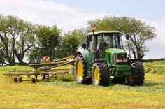 John Deere 6920S Tractor with a Claas Liner 2900 Silage Rake