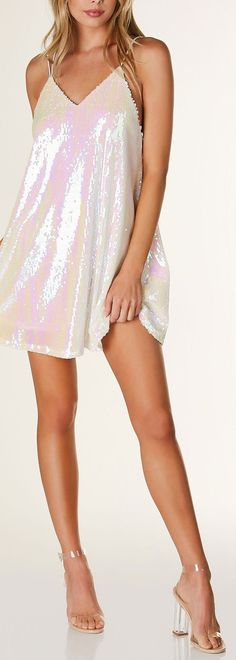 Sleeveless V-neck cami dress with iridescent sequin exterior. Full lining with multi strap design that criss crosses in back. - Self: 100% Polyester - Lining: 100% Polyester - Imported - Model is wear