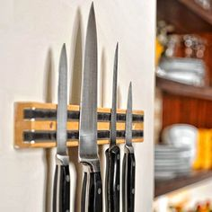 Hang a magnetic knife rack for safely storing knives near your prep station